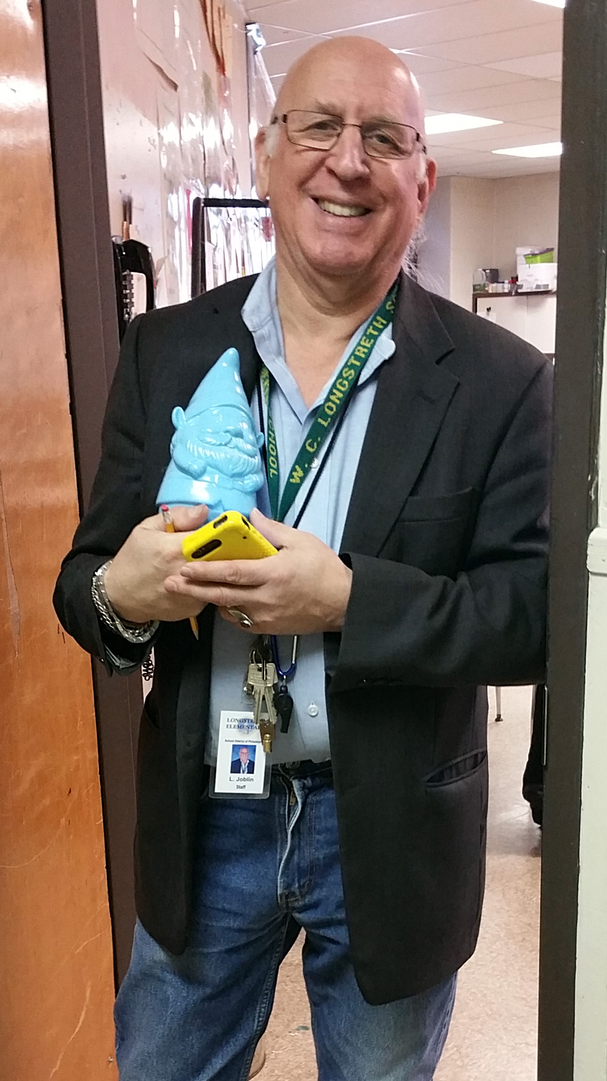 Mr. Joblin shows off the garden gnome he earned